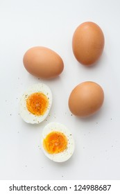 Hard boiled egg halves with whole eggs