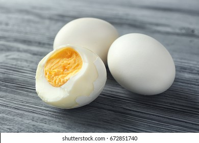 Hard boiled eggs on wooden table. Nutrition concept