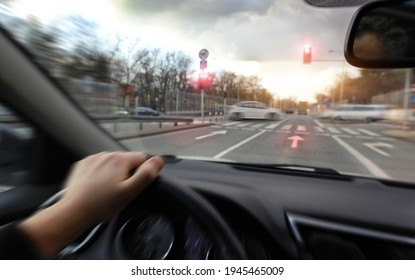 Hard braking in a car before an intersection on red light