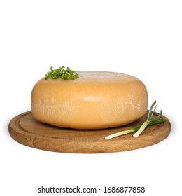 hard cheese head with greens isolated on wooden board