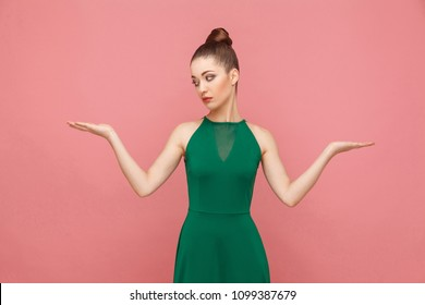 Hard choice. I don't know. Portrait of attractive beautiful puzzled woman. Expression emotion and feelings concept. Studio shot, isolated on pink background