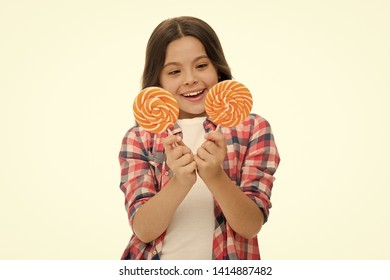 Hard choice. Girl hold two lollipops in hands isolated white. Girl can not decide which lollipop she want. Sweets addicted kid. Which one alternative decision. Make your choice. Pick one lollipop.