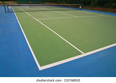 hard court , tennis ball on green blue court and net, sport competition background, sport club