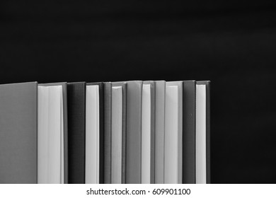 Hard cover books. black and white photography.
