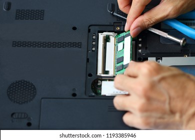 Hard disk drive of laptop with tools on white background.