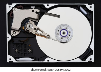 Hard disk drive with removed cover, hdd inside flat view, spindle, actuator arm, read write head, platter, ribbon cable