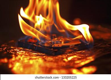 Hard disk failure. Computer hard disk on fire, burning in flames. Computer crash.