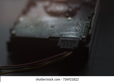 hard disk with serial ATA on a wooden table