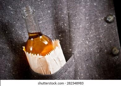 hard drinker hides  bottle in his pocket