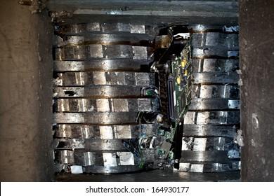 Hard drive crusher shredder used for sensitive data destruction or electronic / media destruction.
