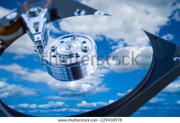 Hard drive disk with sky reflection close-up