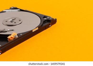 Hard drive on orange background.