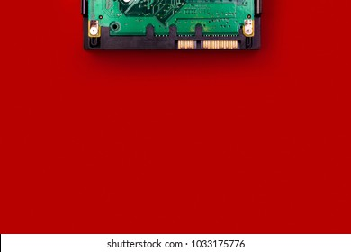 Hard drive on a red background, top view, with space for your text. Computer data storage