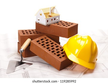 Hard hat with bricks and trowel