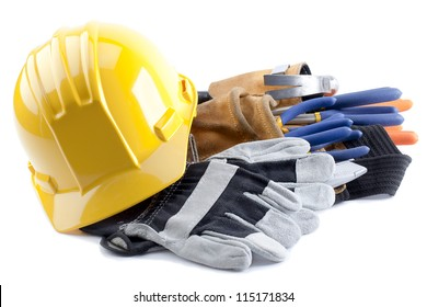 Hard hat and gloves with construction tool belt and carpentry tools inside