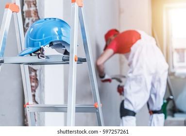 Hard Hat Left on the Ladder. Construction Safety Concept.