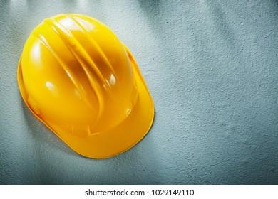Hard hat on concrete background.