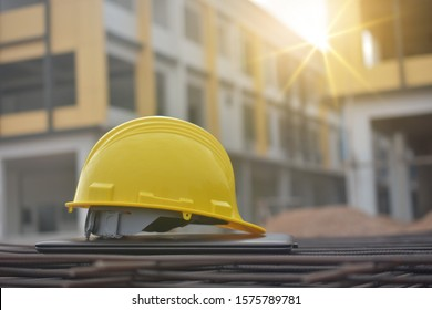 Hard hat safety on computer notebook building construction estate background