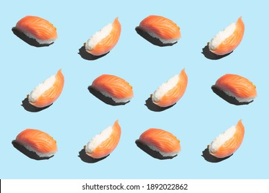 Hard light pattern of one nigiri-sushi photographed in variations on light blue background