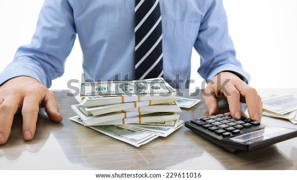 Hard money lender / close-up photo of successful boss working with calculator in the office