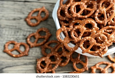 Hard Pretzels or Salted pretzels snack for party in white bowl on wooden floor.
