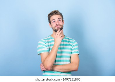 Hard question. Man serious face thoughtful. Have some doubts. Thoughtful expression. Need to think. Find solution. Hipster bearded face not sure in something. Thoughtful man on blue background.
