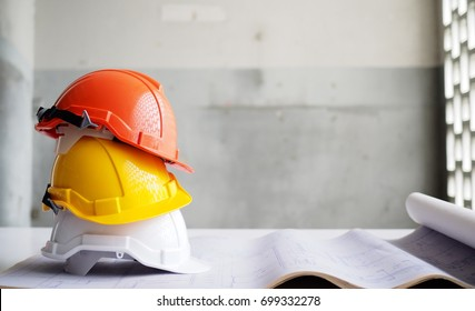 Hard safety helmet hat for safety project of workman as engineer or worker on concrete floor.