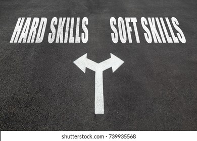 Hard skills vs soft skills choice concept, two direction arrows on asphalt.