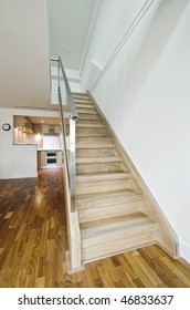 hard wood staircase in a modern luxury duplex apartment