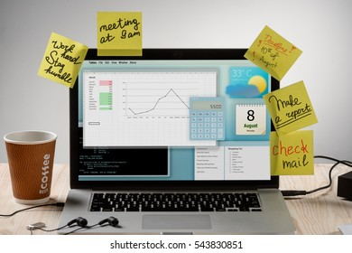 Hard work of an office employee with a lot of tasks and pressing deadline written on sticky notes. Modern laptop with headphones connected to it. Work avalanche at the office.
