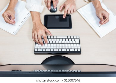 hard working asian businessman, male employee hands with computer on workspace desk in office