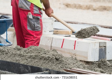 Hard working construction industry - man with a shovel.