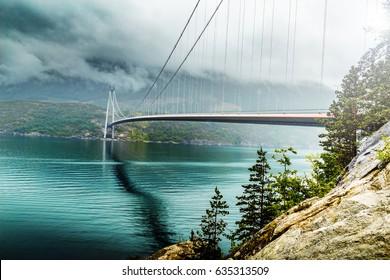 Hardanger bridge - suspension bridge across the Eidfjorden branch of Hardangerfjorden in Hordaland county, Norway. The bridge connects the municipalities of Ullensvang and Ulvik. Norway, Scandinavia.