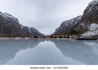 Hardanger fjord frozen smooth in winter Norway