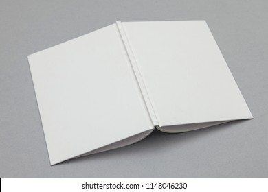 Hardback book mockup. White book on a grey background