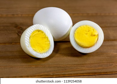 Hardboiled eggs with one cut in half on the kitchen table