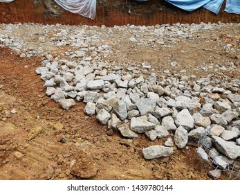 Hardcore fills irregularities in excavations and make a firm evenly spread working base onto which concrete can be laid in construction site.