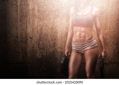 Hardcore training fitness woman with powerful body core
