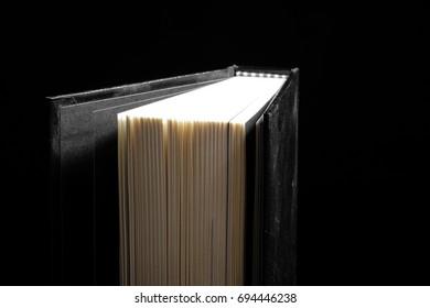 Hardcover book in black background - Soft focus