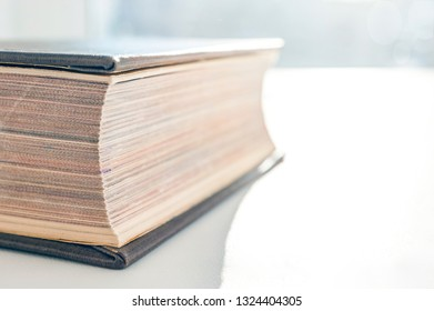 Hardcover Book, Fore Edge, Closed Pages On White Background on a Sunny Day. Reading, Textbook, Business Leger, Cookbook, Fiction Literature, Bestseller Concept. Copy Space.
