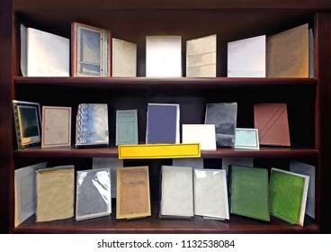 Hardcover books arranged tidy on wooden bookshelf