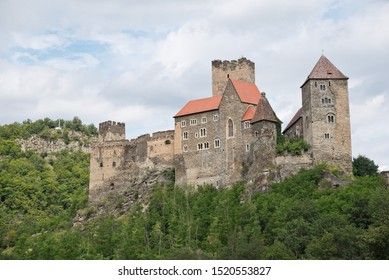 Hardegg medieval castle on a fortified hill in Thayatal National Park on sunny day with cloudy blue sky.