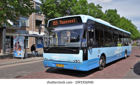 Harderwijk / Netherlands - May 10 2015: A blue dutch public transport bus of Syntus in the town Harderwijk on the Veluwe. The bus is a VDL Berkhof Ambassador.