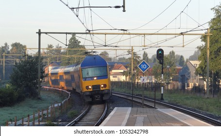 Harderwijk / Netherlands - September 29 2015: A dutch train of the NS drives through a track bend by the town Harderwijk