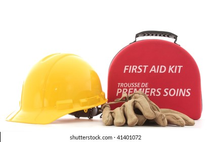 A hardhat, gloves, and a first-aid kit to promote safety in the workplace.