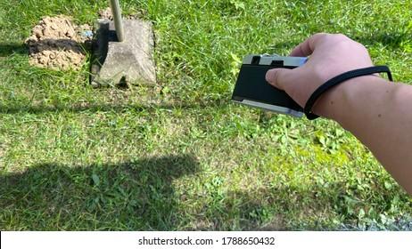 Harding film camera against yard in Japan