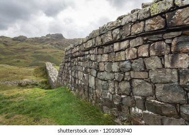 Hardknott Roman Fort is an archeological site, the remains of the Roman fort Mediobogdum, located on the western side of the Hardknott Pass in the English county of Cumbria in the Lake District