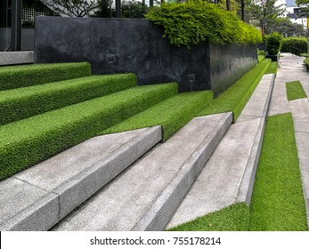 Hardscape of modern building stairway decoration with artificial grass / park and outdoor design conceptual