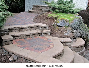 Hardscape staircase residential entrance concrete blocks pavers stones as materials new design on existing garden landscape steps landing and walkway background