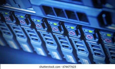 Hardware of array disk storage online in data center or server room with depth of field in blue tone , technology concept